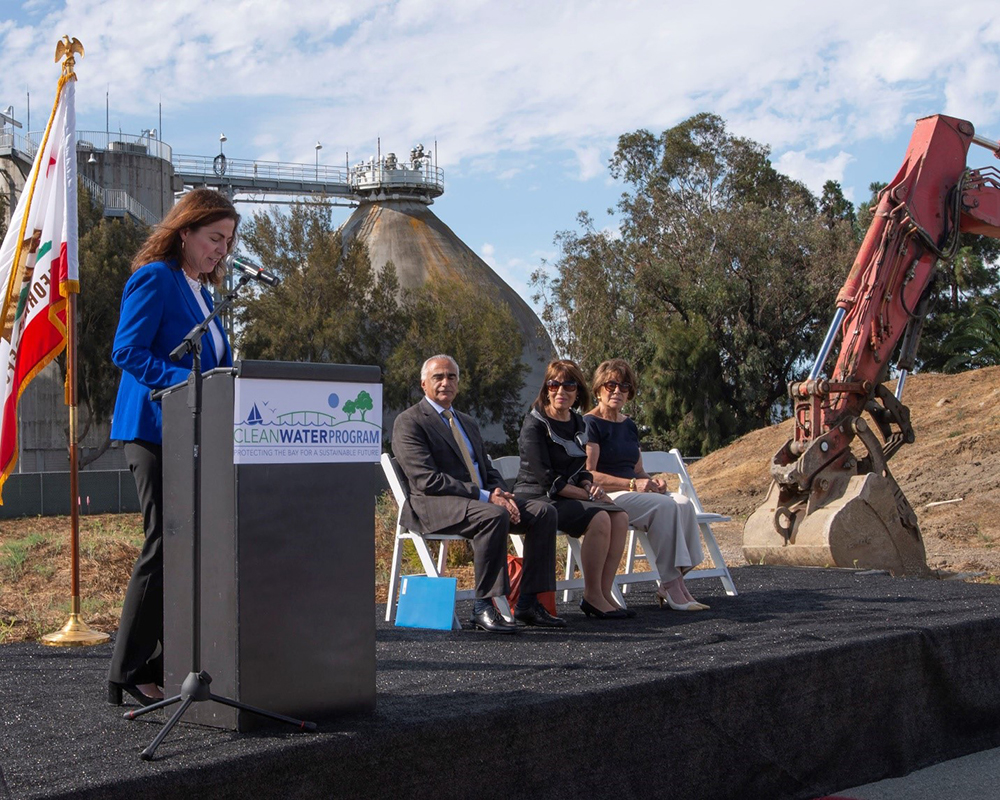 Left to right, San Mateo Mayor Diane Papan, Foster City Mayor Sam Hindi, Representatives Jackie Speier and Anna Eshoo on the site of the new wastewater treatment plant. In the background is the existing plant, which has not seen a major upgrade since the 1970's.